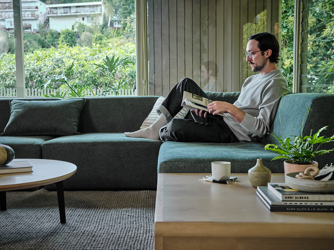 sectional sofa in living space with man