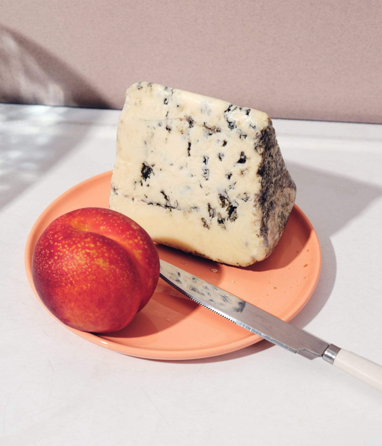 plate with cheese and fruit