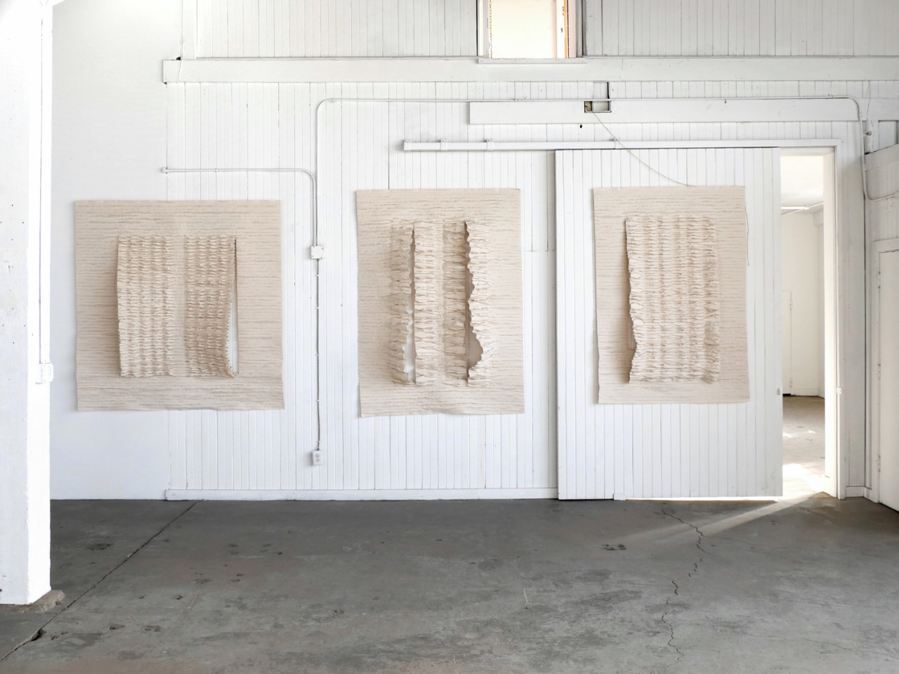 Mary Little's Undulating Sculptures Take Residence in an Abandoned Warehouse