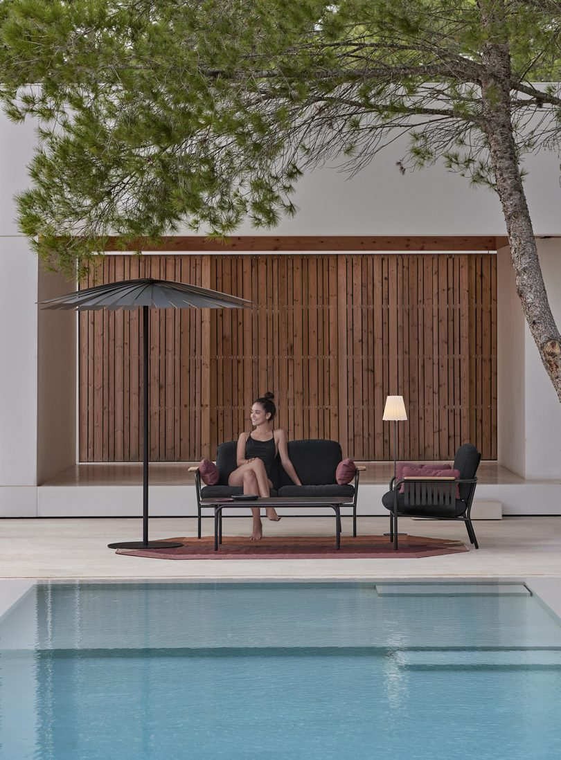 outdoor furniture by pool with model
