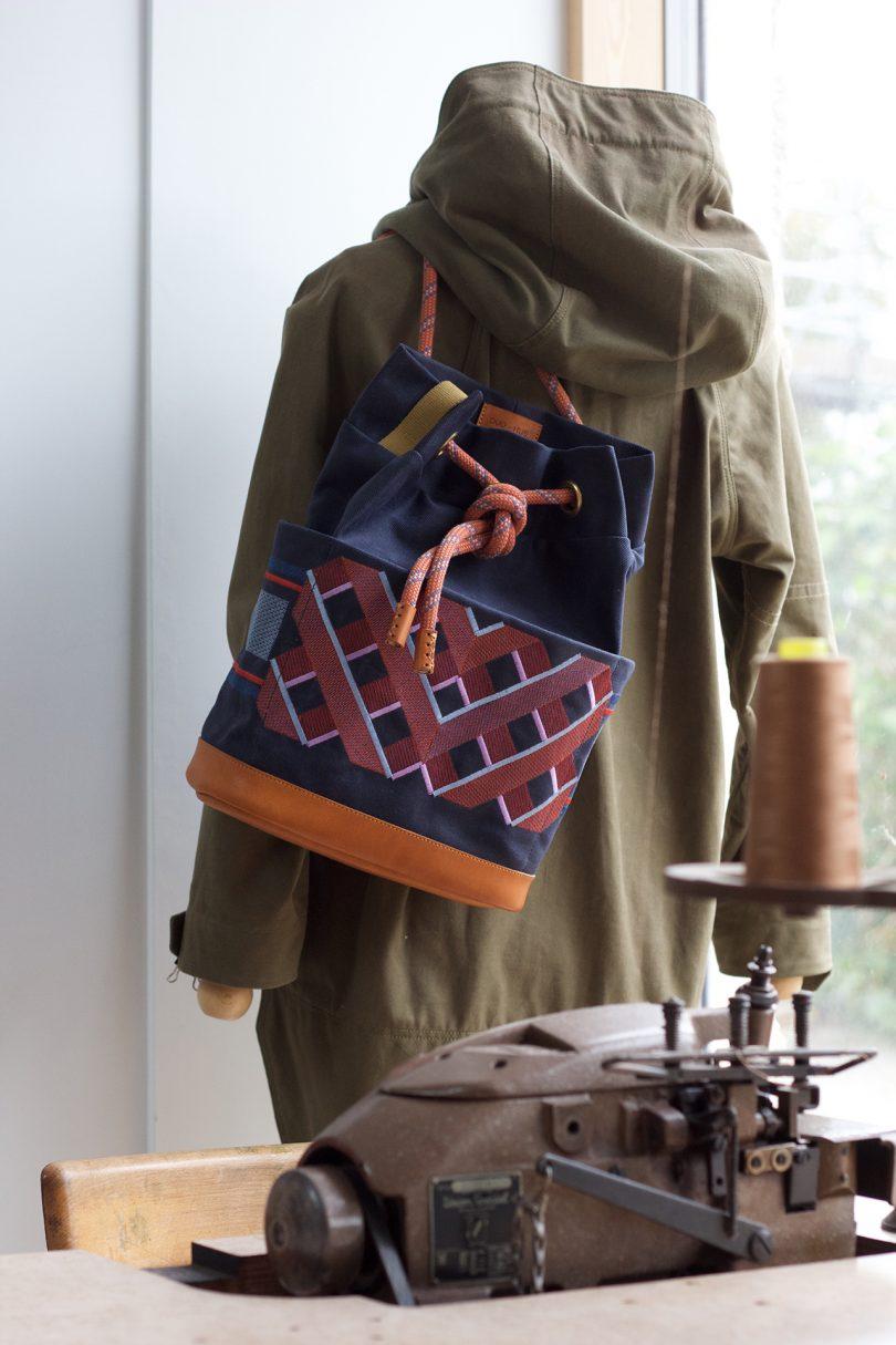 backpack slung over shoulder