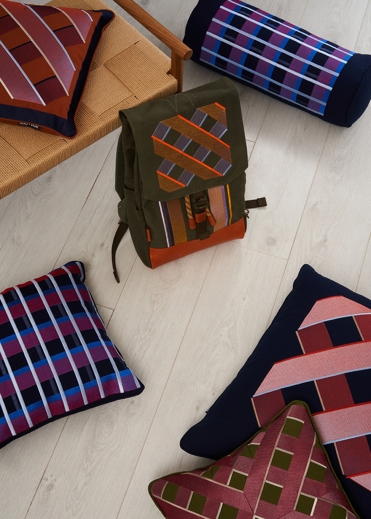 interior space with various textiles and backpack