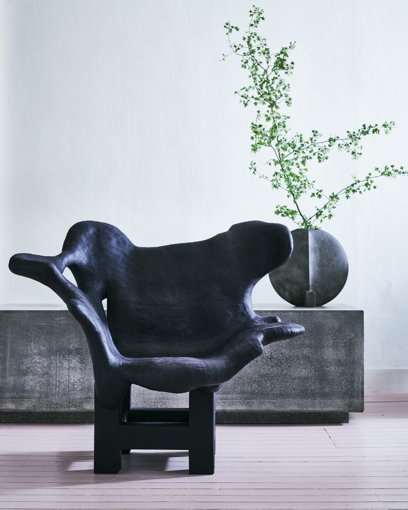 sculptural chair and credenza