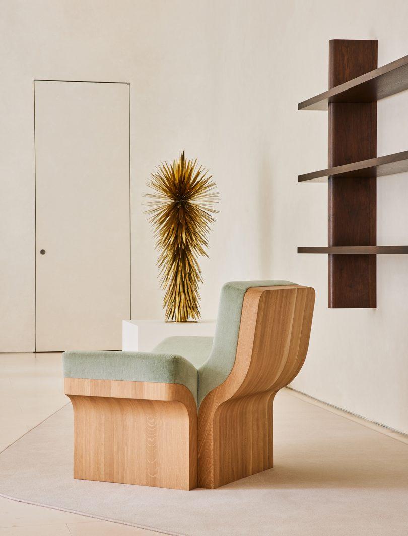 chair, sculpture, wall shelves