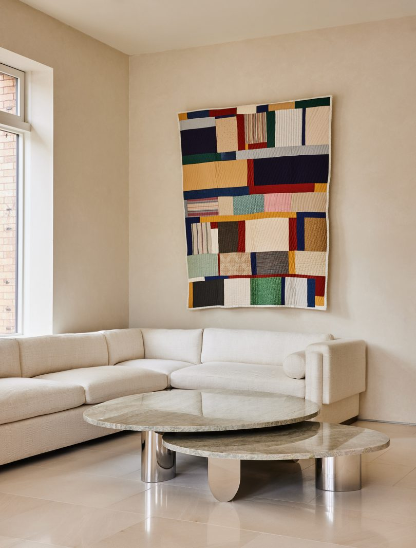 living space with coffee tables and textile wall art