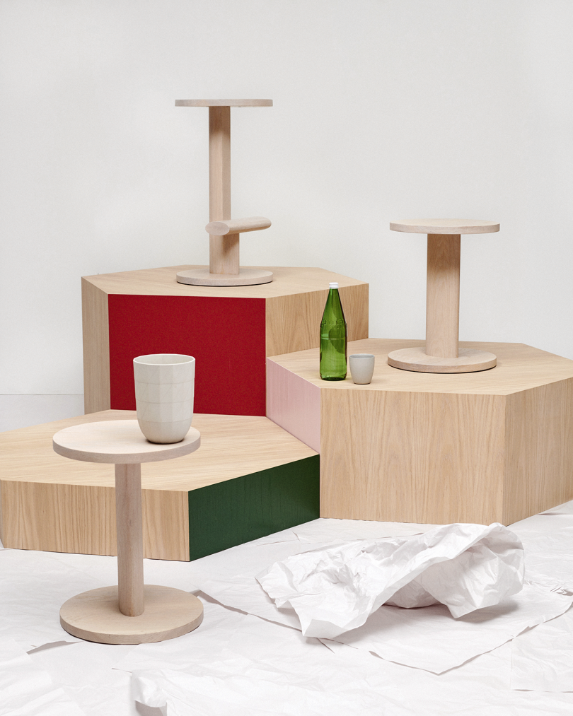 three side tables on risers