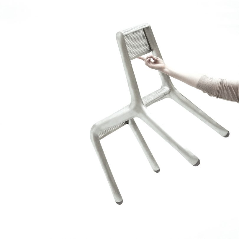 arm holding up chair with finger