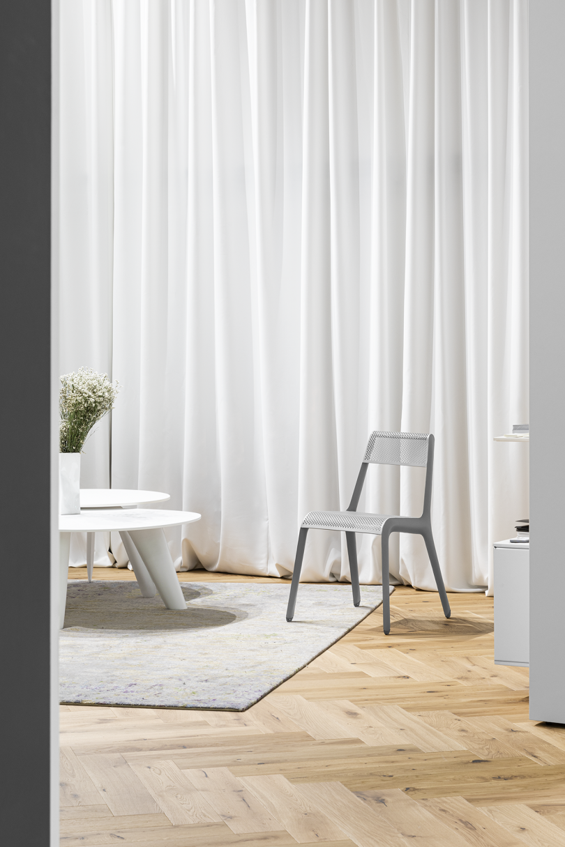 tables and chair in front of curtain