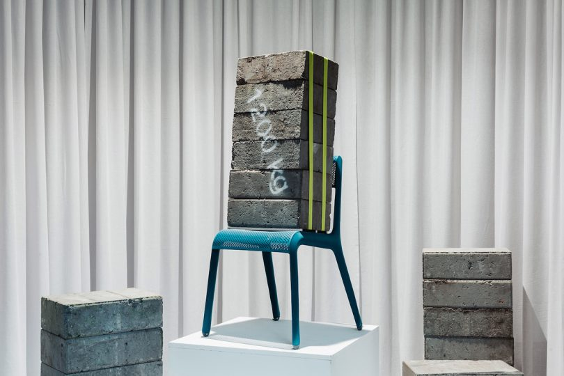 chair holding cement block weights