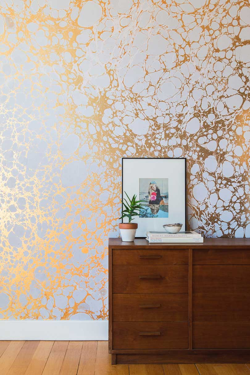 a wall with marbled wallpaper