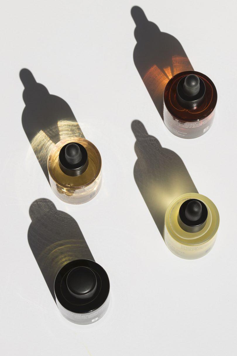 four bottles of face oil