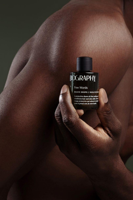 hand holding bottle of face oil
