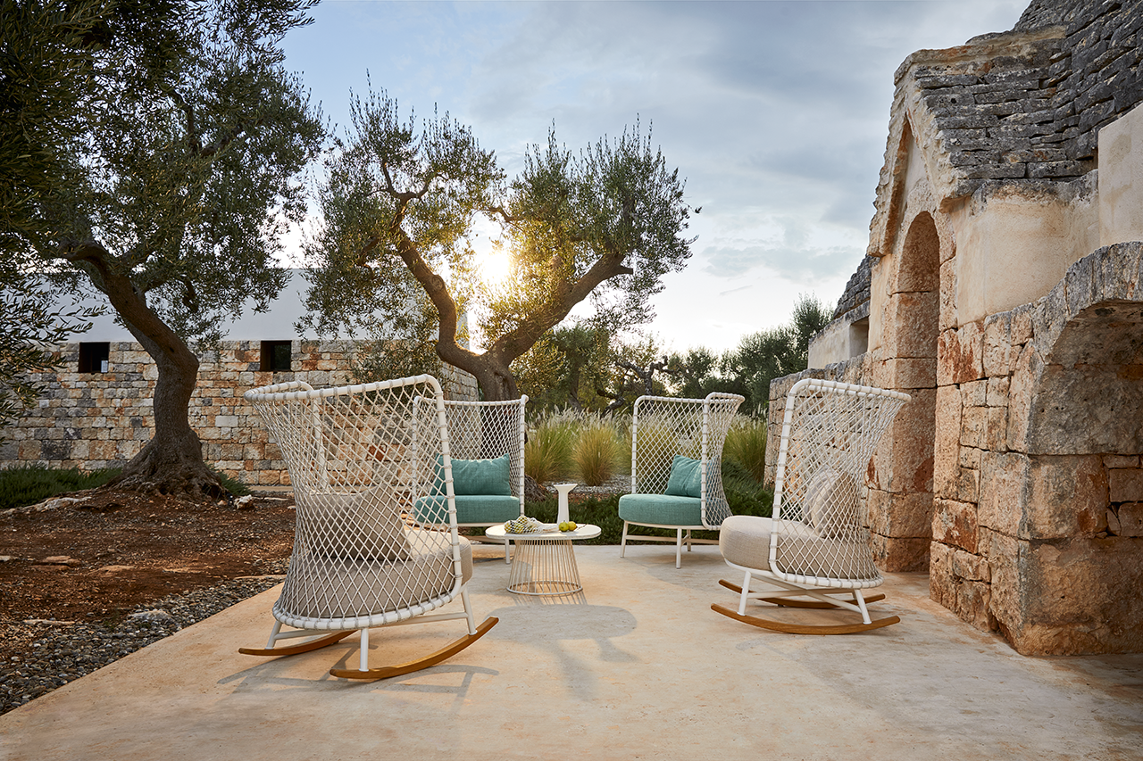 four outdoor rocking chairs
