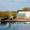 outdoor furniture next to pool