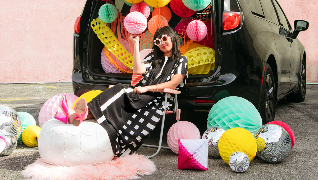 Joy Cho sitting in front of decorated mini van