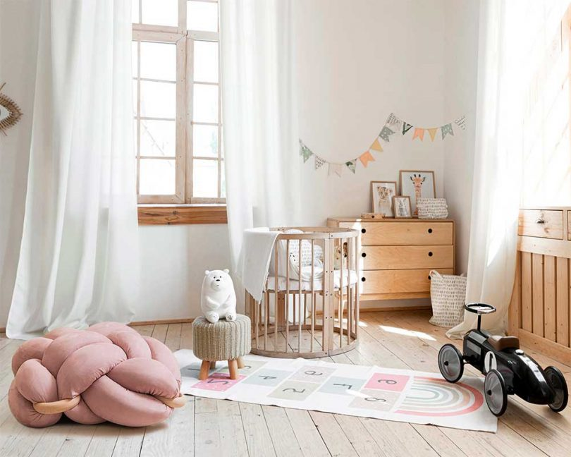 pink knot floor cushion in nursery