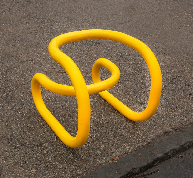 sculptural chair on sidewalk