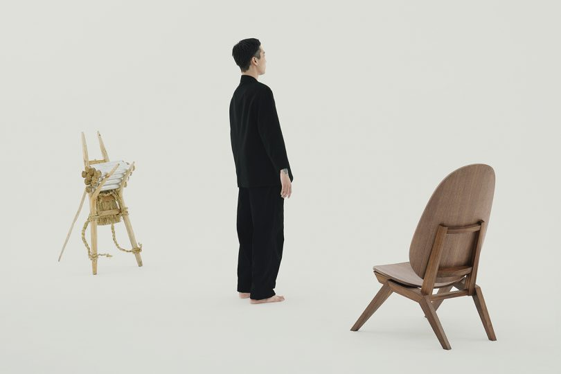 person standing between a chair and ji-gae