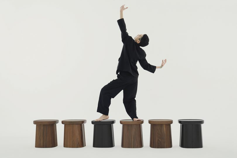 person walking across row of side tables