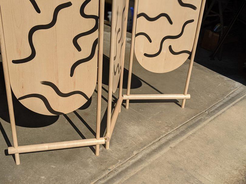 closeup patterned wood folding screen