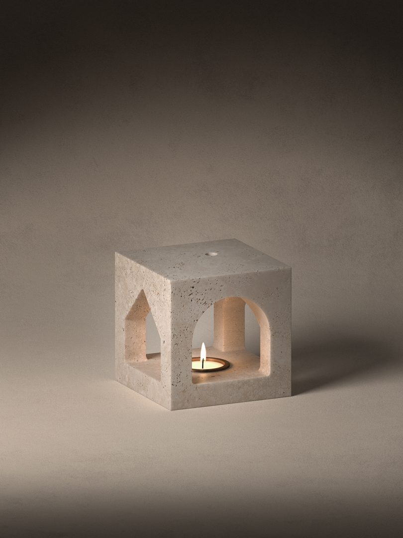 stone sculpture with lit candle