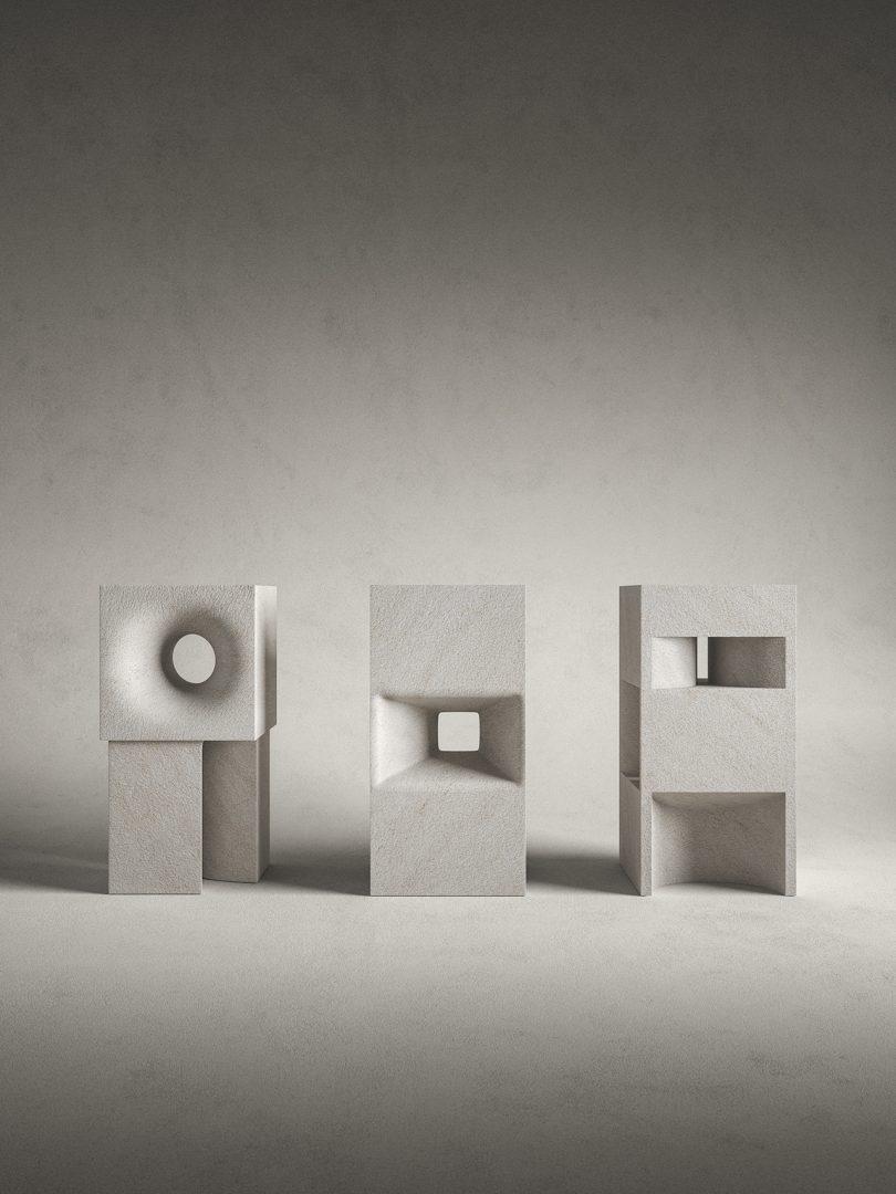 three grey stone sculptures