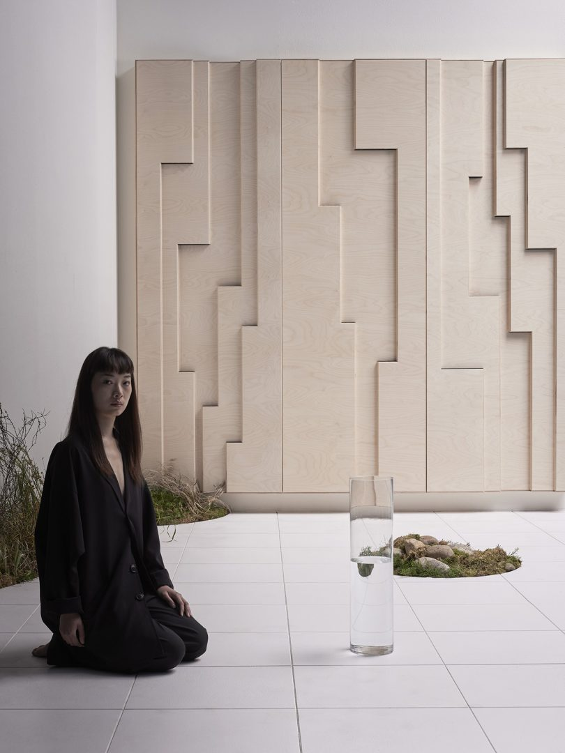 woman sitting in front of wall panels