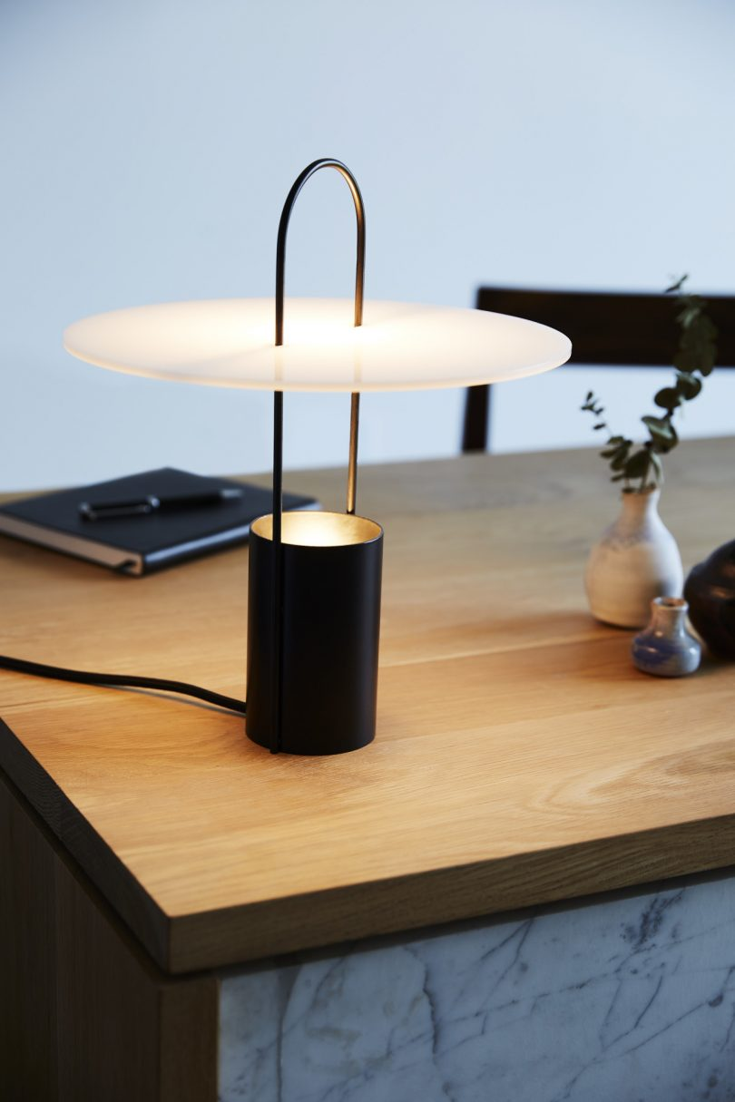 lit table lamp on desk