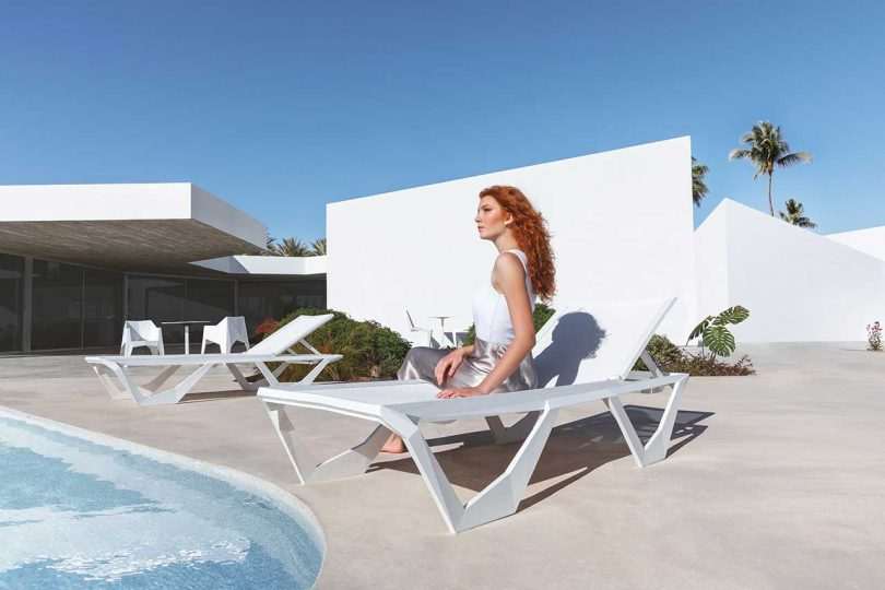 woman sitting poolside on lounger