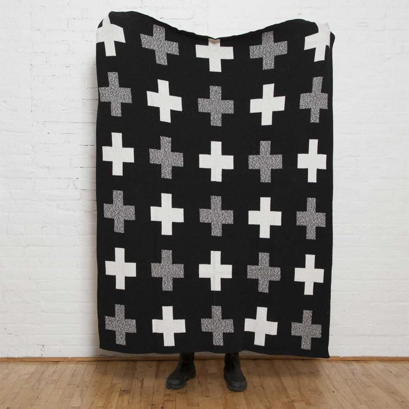 black, grey and white throw blanket