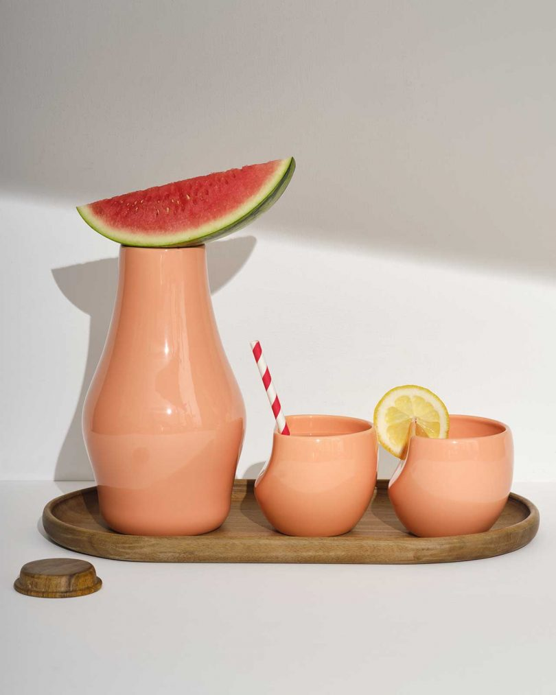 peach colored carafe with peach cups