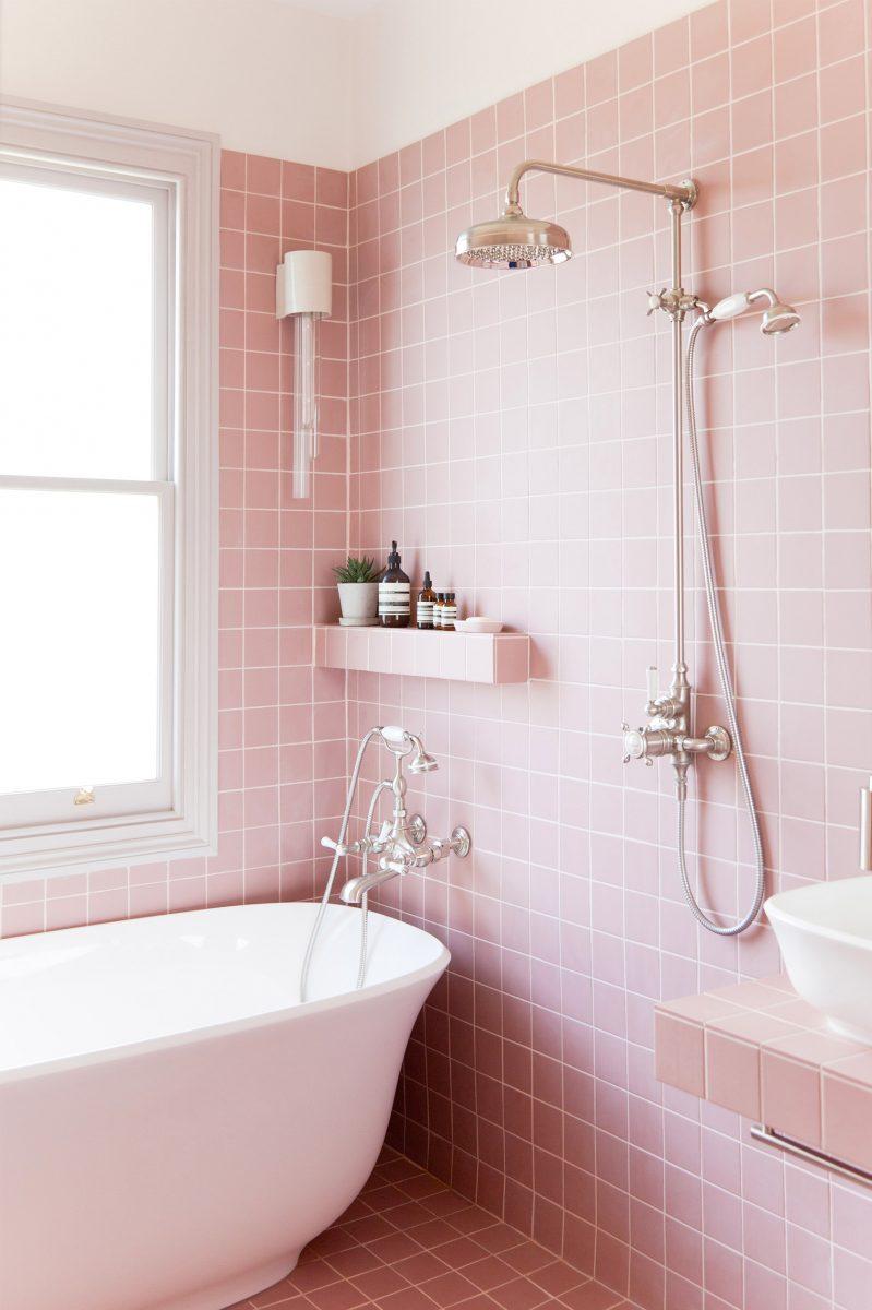 pink tiled bathroom with tub