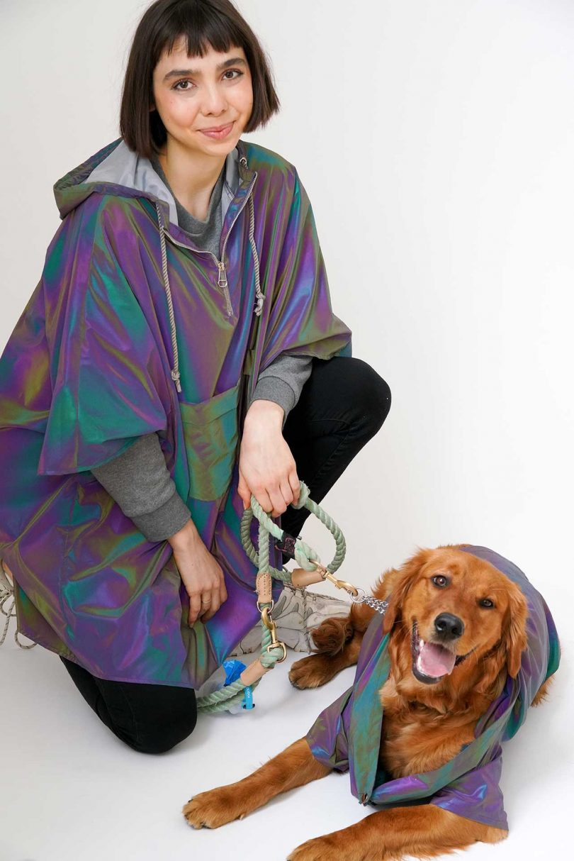 Person and dog wearing matching raincoats