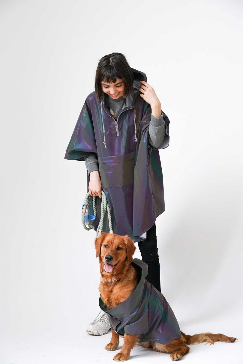 person and dog in matching raincoats
