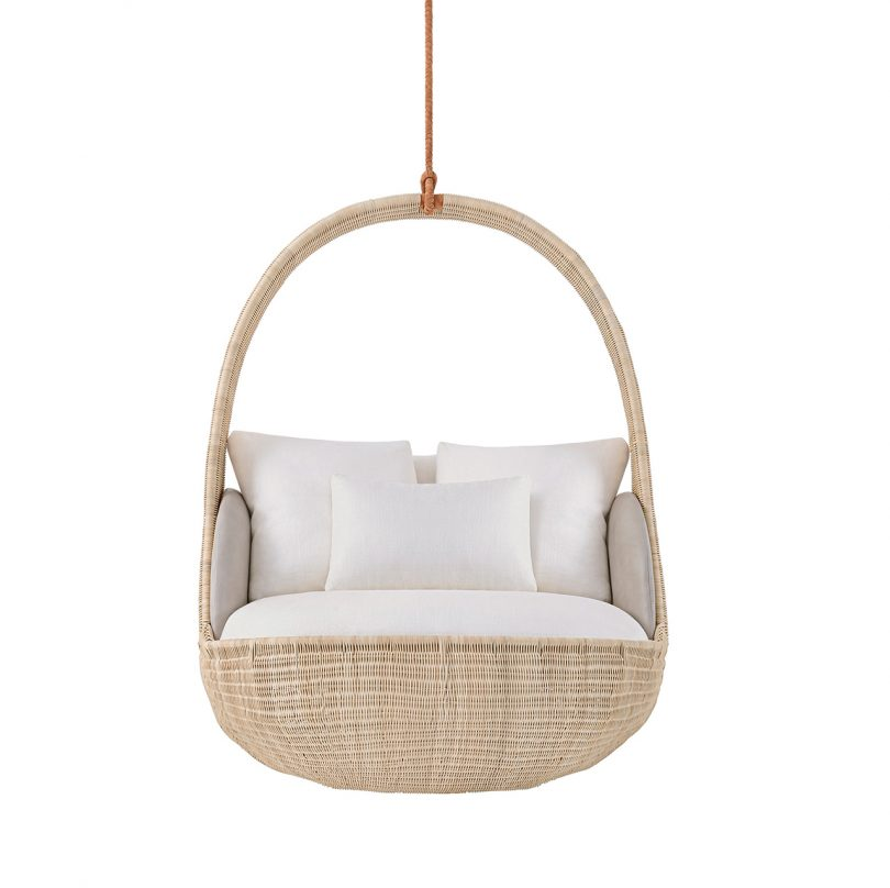 front view of hanging chair with white upholstery on white background