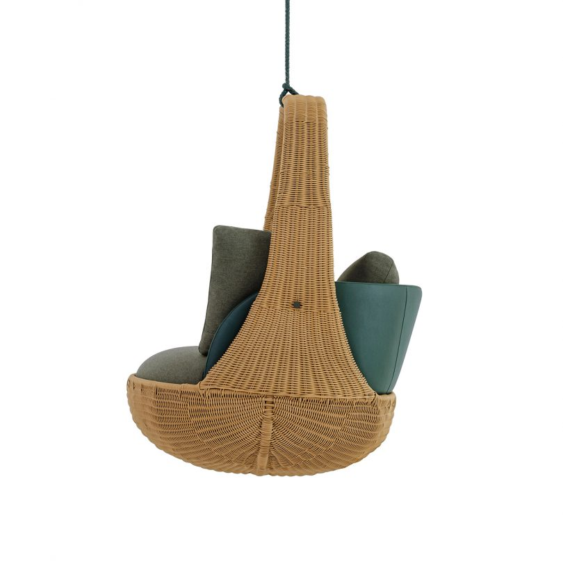side view of hanging chair with dark upholstery on white background