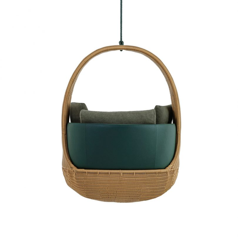 back view of hanging chair with dark upholstery on white background