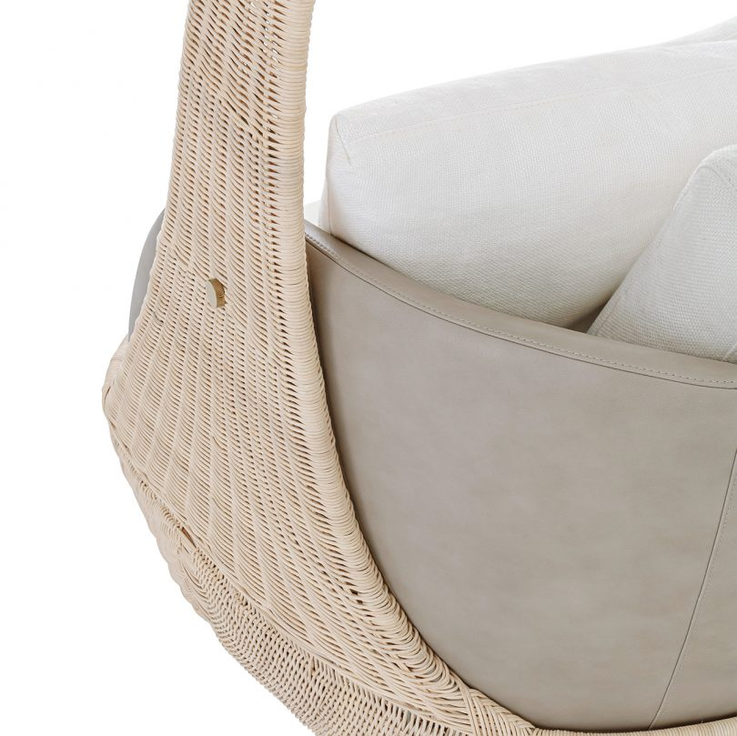 detail photo of hanging chair with white upholstery on white background