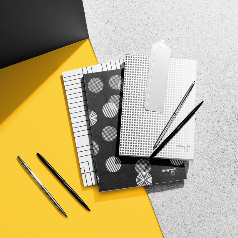 collection of patterned Design Milk 15th anniversary stationery on yellow and grey background