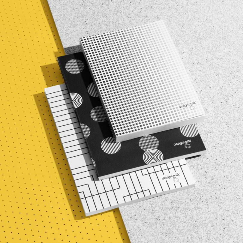 patterned Design Milk 15th anniversary stationery on yellow and grey background