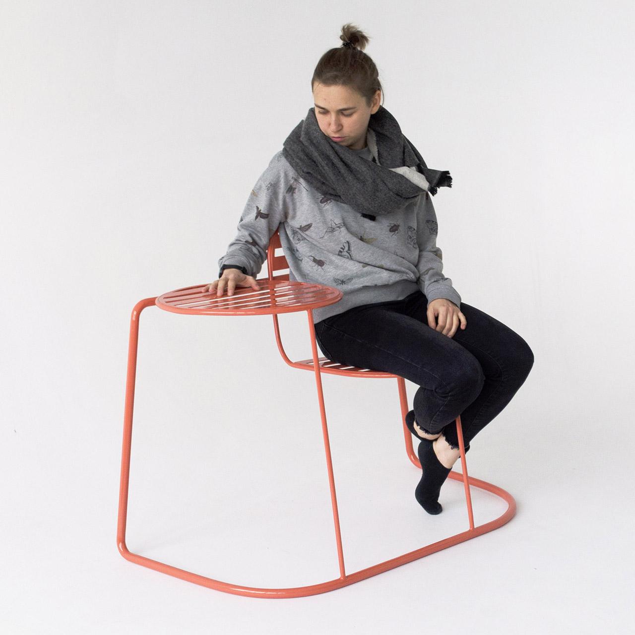 woman using metal outdoor seating