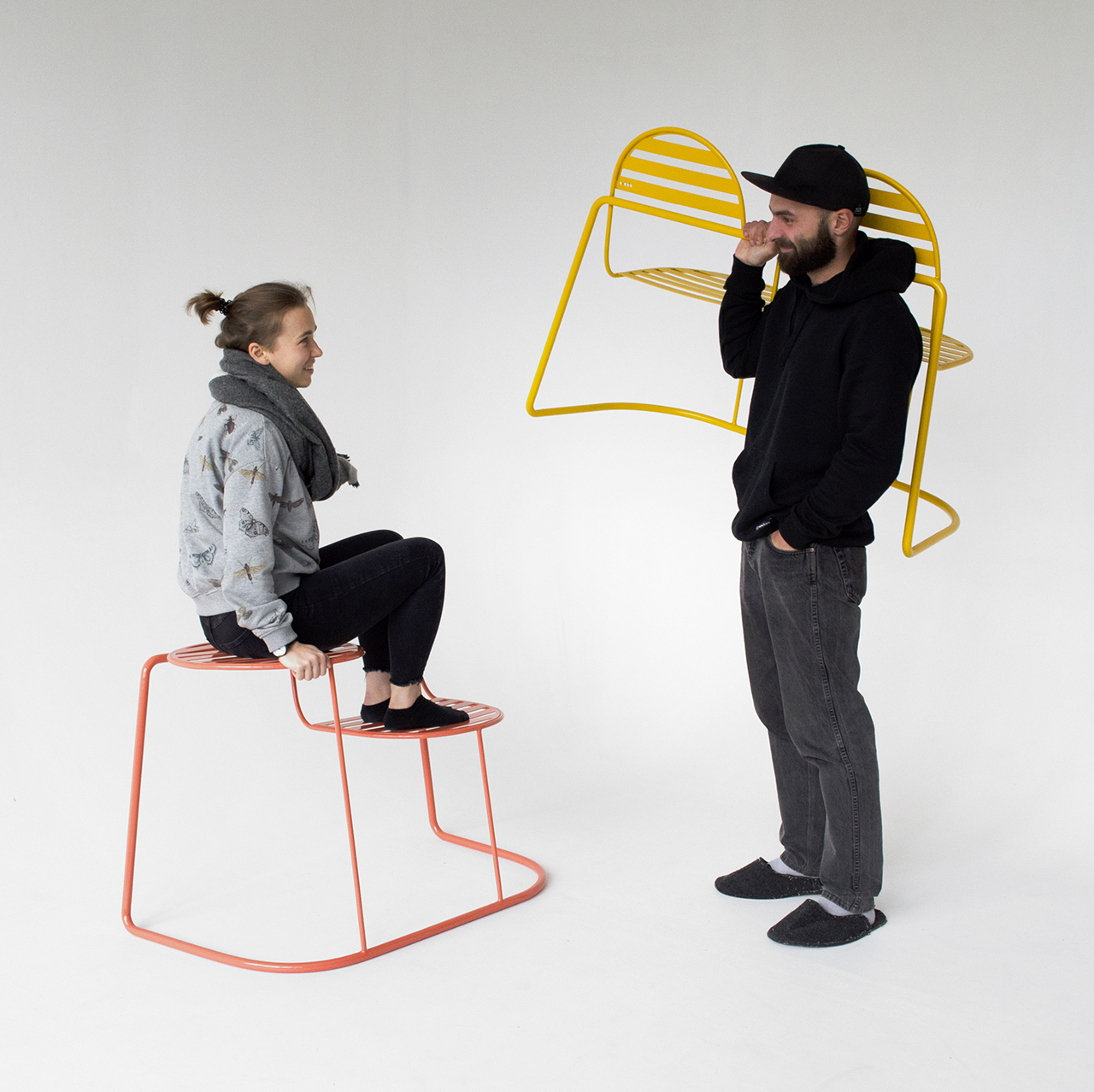 two people with metal outdoor seating