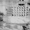 black and white photo of house being built with textile blocks