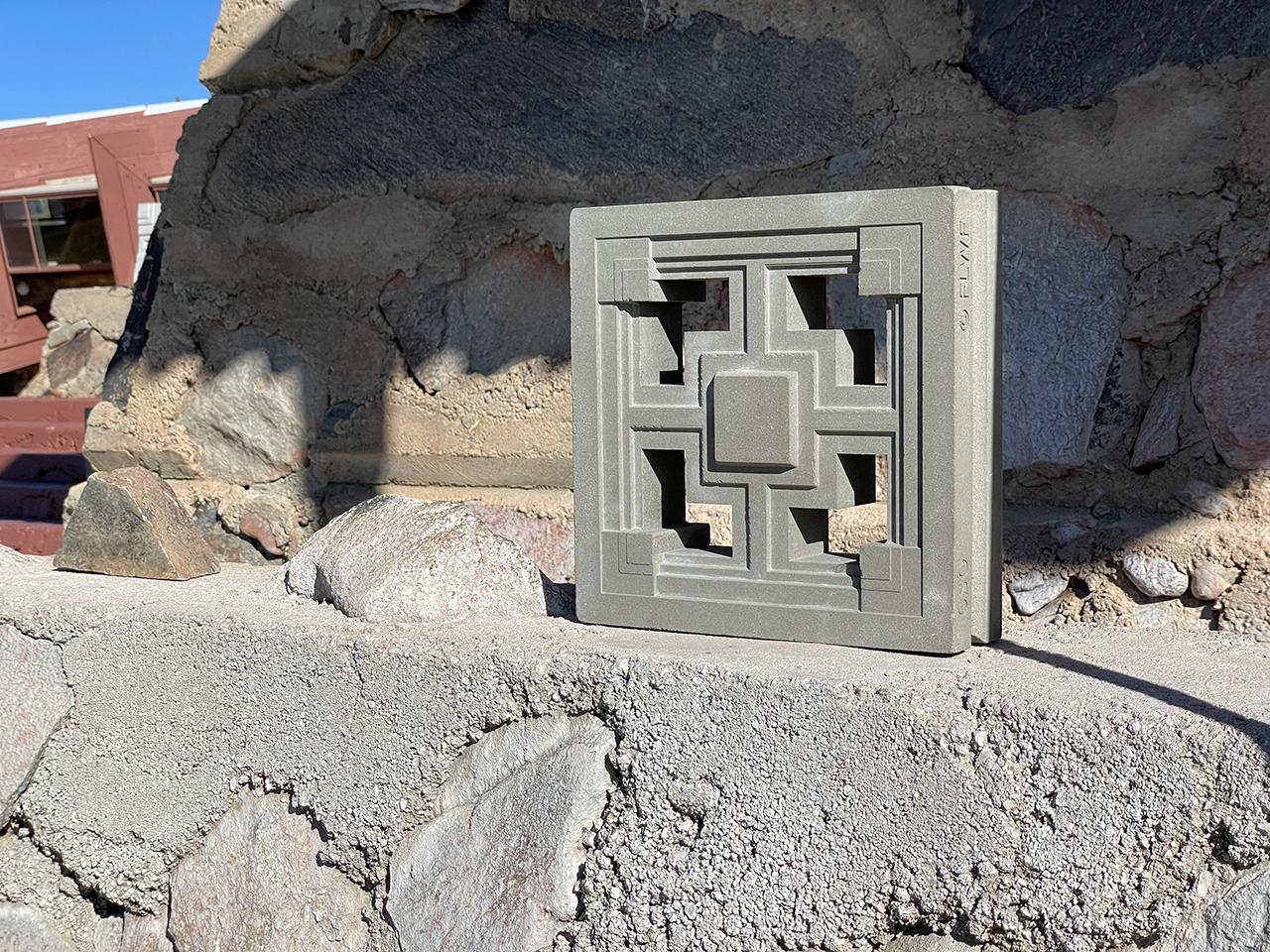 Storer textile block sitting on cement ledge