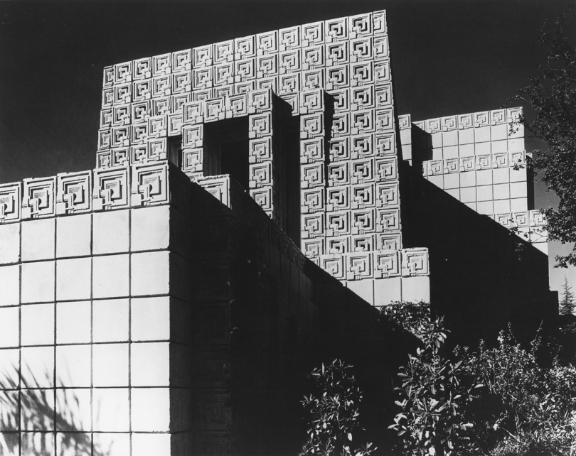 black and white photo of cement tile building