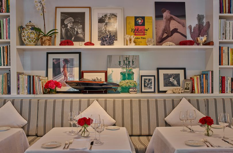 interior of home-like restaurant with striped banquet