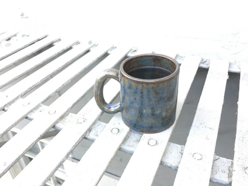 blue mug on white slatted table