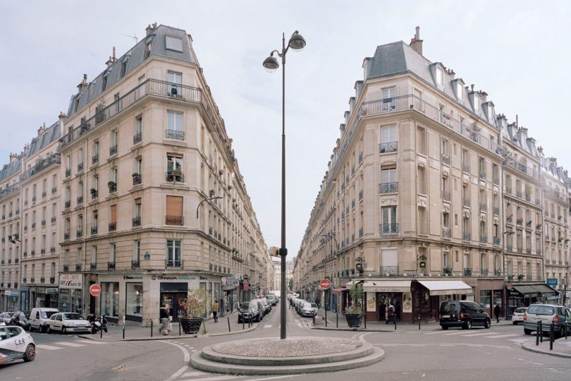 two large Parisian buildings with street in between