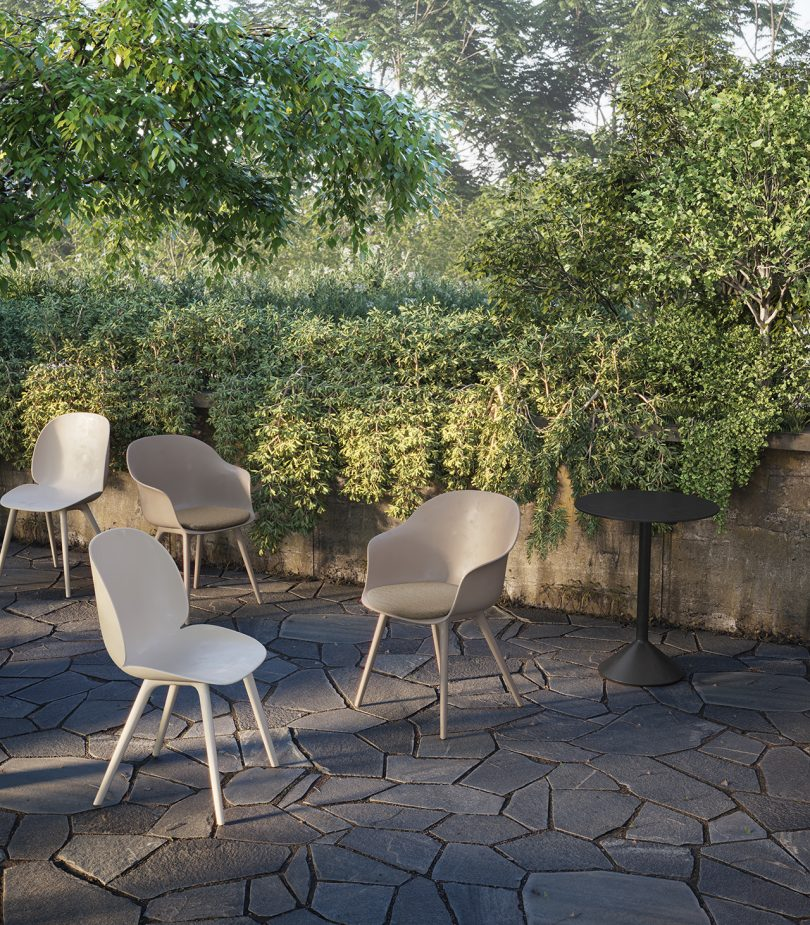 four chairs outdoors against green foliage