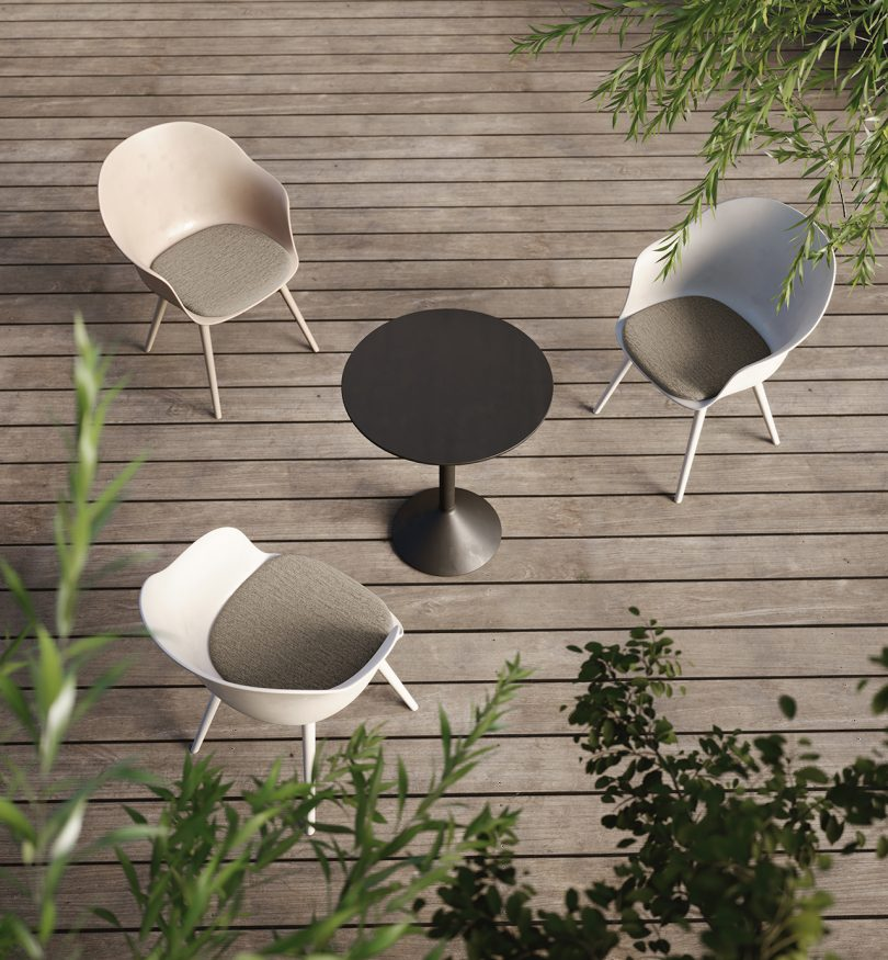 three chairs and table on a deck